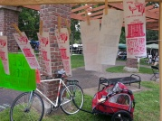 We traveled by bike & trailor. Thanks to Red Hot Art & Chuck U for helping us with a folding table and tent!